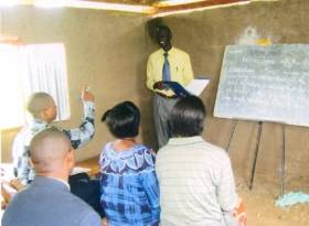 Lecturing to trainees in Yei